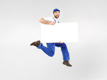 Portrait of handsome builder with empty board Royalty Free Stock Photography