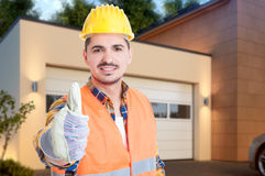 Portrait of handsome builder showing like sign Stock Images