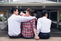 Complicated Love triangle or threesome. Portrait of Handsome Burmese or Myanmar men with longyi traditional dress perform salute or pay respect hand sign in Royalty Free Stock Photo