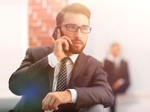View of a Young attractive business man using smartphone. Portrait of handsome business man using cell phone Stock Photo