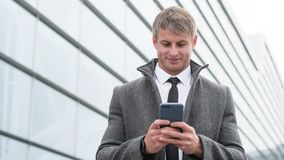 Portrait of handsome business man using smartphone and drinking royalty free stock photos