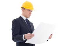 Portrait of handsome business man in yellow builder's helmet wit Royalty Free Stock Photos