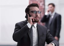 View of a Young attractive business man using smartphone. Portrait of handsome business men using cell phone Stock Photos