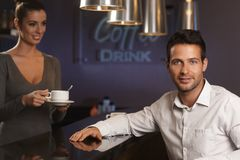Portrait of handsome businessman in bar Royalty Free Stock Images