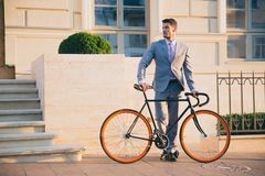 Portrait of a handsome businessman with bicycle Royalty Free Stock Images