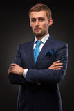 Portrait of handsome businessman on black Royalty Free Stock Photo
