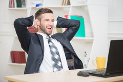 Portrait of handsome businessman enjoying the Stock Images