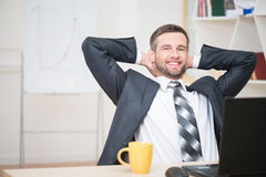 Portrait of handsome businessman enjoying the Royalty Free Stock Photography