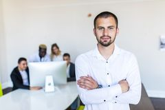 Portrait of an handsome businessman in front of his team. Team work royalty free stock photo