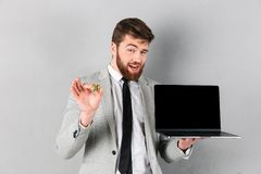 Portrait of a handsome businessman holding bitcoin Royalty Free Stock Image