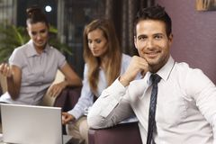 Portrait of handsome businessman in lobby Royalty Free Stock Image