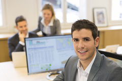 Portrait of handsome businessman in modern office. looking camer Stock Images