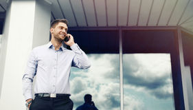 Portrait of an handsome businessman on office building backgroun Royalty Free Stock Photography