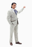 Portrait of a handsome businessman pointing at a copy space Royalty Free Stock Images