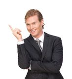 Businessman Pointing Finger Up Stock Photo