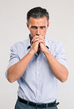 Portrait of a handsome businessman praying Royalty Free Stock Images
