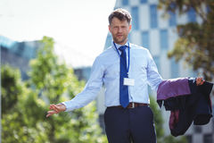 Portrait of handsome businessman standing with blazer Royalty Free Stock Photo