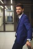 Portrait of handsome businessman standing in corridor Stock Photo