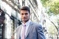 Portrait of a handsome businessman in suit outdoors Stock Photo