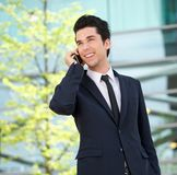 Portrait of a handsome businessman talking on mobile phone outdoors Stock Photography