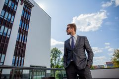 Portrait of an handsome businessman in an urban setting. Royalty Free Stock Images