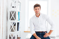 Portrait of a handsome businessman in white shirt stock images
