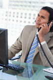 Portrait of a handsome businessman working with a monitor while Royalty Free Stock Photography