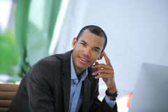 Portrait of a handsome businessman on a workplace Stock Images