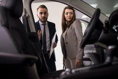 Salesman Presenting Luxury Car royalty free stock photo