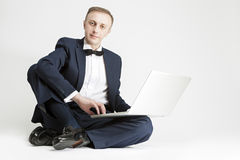 Portrait of Handsome Caucasian Man in Suit with Laptop. Royalty Free Stock Image