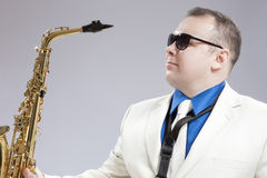 Portrait of Handsome Caucasian Saxophone Player With Music Instr Stock Photos