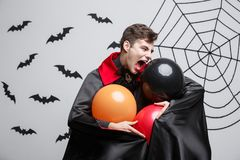 Portrait of handsome caucasian in Vampire halloween costume with colorful Balloon. Vampire Halloween Concept - Portrait of handsome caucasian in Vampire Royalty Free Stock Photography