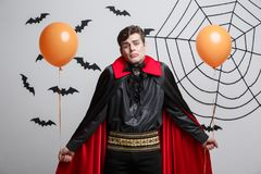 Portrait of handsome caucasian in Vampire halloween costume with colorful Balloon. Vampire Halloween Concept - Portrait of handsome caucasian in Vampire Royalty Free Stock Images