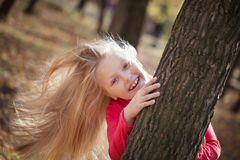 Portrait of handsome cheerful girl with long hair in autumn park, Royalty Free Stock Photo