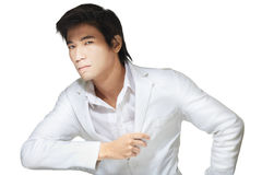 Portrait of handsome Chinese man in white. Portrait of handsome Chinese man dressed formally in all white attire, shirt and jacket Stock Photography