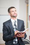 Portrait of handsome confident businessman writing Stock Images