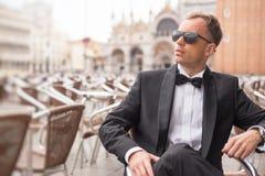 Portrait of handsome confident man in tuxedo stock photos