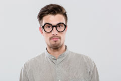 Portrait of handsome confident student in black round glasses Stock Images
