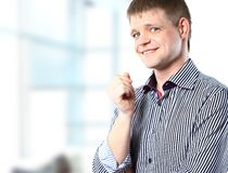 Portrait of handsome confident young businessman standing Royalty Free Stock Image