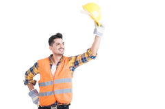Portrait of handsome constructor or engineer raise his helmet up Royalty Free Stock Photos