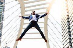 Portrait handsome cool guy. Attractive handsome man is jumping a stock image