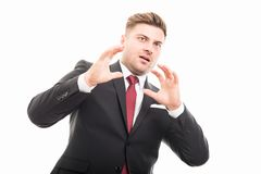Portrait of handsome corporate business man looking scared royalty free stock photo