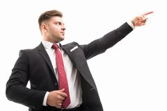 Portrait of handsome corporate business man pointing up stock photos