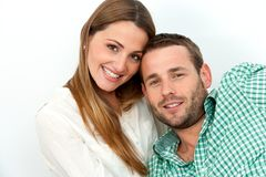Portrait of handsome couple with heads together. Royalty Free Stock Images