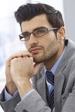 Portrait of handsome daydreaming businessman Royalty Free Stock Image