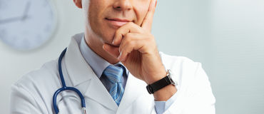 Portrait of a handsome doctor Stock Images