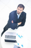Portrait of a handsome elderly business man standing isolated on Stock Photo