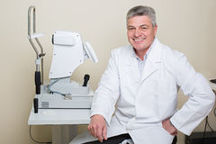 Portrait of handsome elderly eye doctor Stock Photo