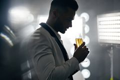 Portrait of a handsome, elegant man drinking champagne Stock Images