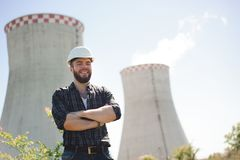Portrait of an handsome engineer. Handsom electrical engineer at an electrical station. stock photography